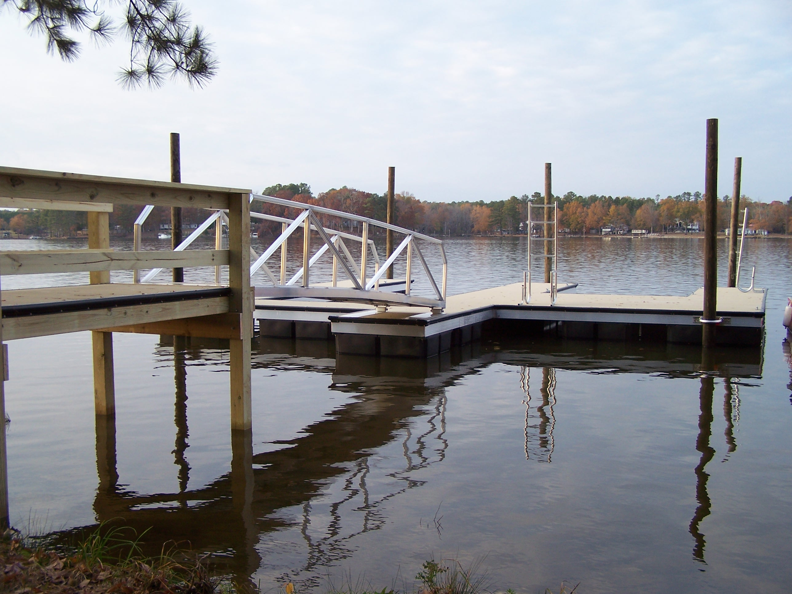 Dock Anchoring System with fixed pilings
